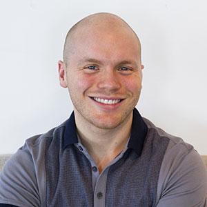 Candid portrait of Sam Eckmeier, Junior Developer