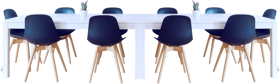 A conference room table with chairs